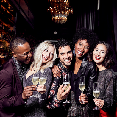 Group of men and women enjoying cocktails