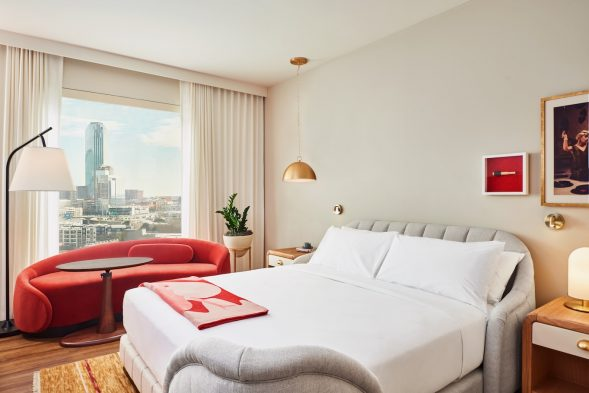 Chamber King (guest room) with patented bed technology and Dallas skyline view at Virgin Hotels Dallas