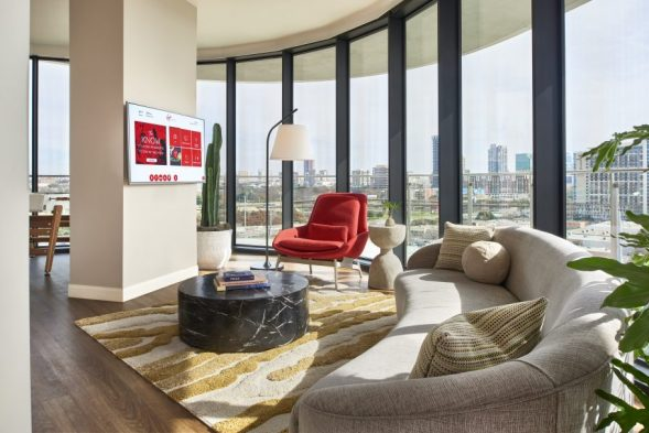 Grand Chamber King Suite living area with Dallas skyline views and wrap around terrace balcony